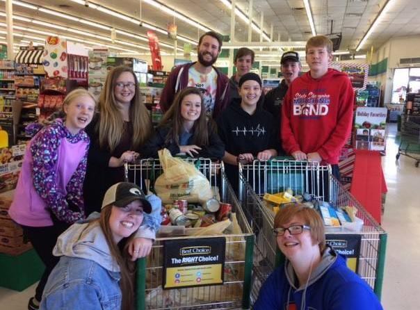 Bixby Church of Christ youth group collecting food donations at Doc's Country Mart