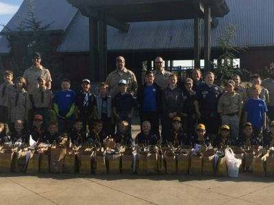 Boy Scout Pack 142 donates food to BOC.