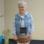 Sheila with cake at retirement reception.