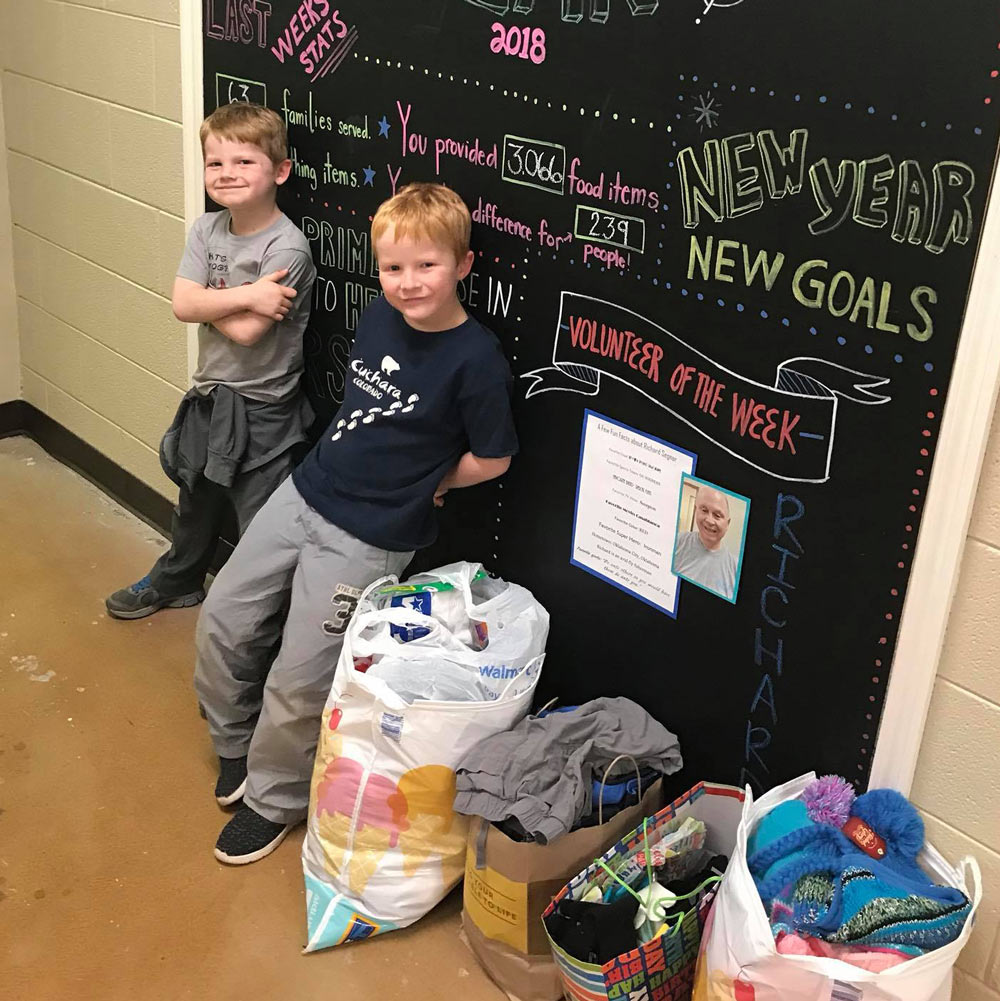 Brothers donate items for their birthday to the BOC.