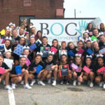 Spartan Cheer team with back to school donations.